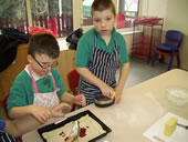 Two children cooking together
