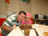 Father and Daughter with cake
