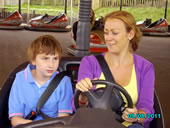 Student and teacher on the Dodgems