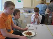Senior pupils eating together