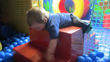 Pupil in a soft play ball pit