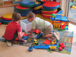 Children playing together inside the Nursery