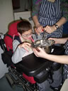 Pupil mixing ingredients in a bowl