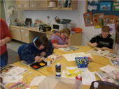Pupils sat at table painting