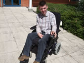 Pupil on his wheelchair outside