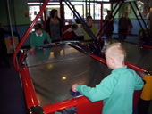 Students playing air hockey