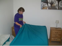 Student making a bed in the flat