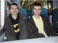 Two students travelling by train