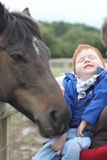 Pupil next to a horse